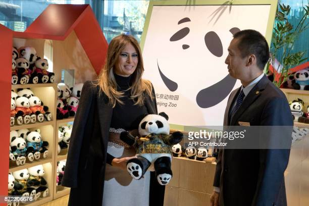 US First Lady Melania Trump poses for a photograph following a visit to the panda enclosure at the zoo in Beijing on November 10 2017 / AFP PHOTO /...