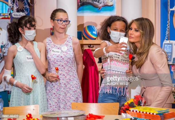 First Lady Melania Trump poses for a selfie as she visits the Queen Fabiola children's hospital on the sidelines of the NATO summit on May 25 in...