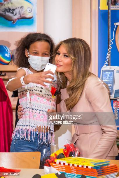US First Lady Melania Trump poses for a selfie as she visits the Queen Fabiola children's hospital on the sidelines of the NATO summit on May 25 in...