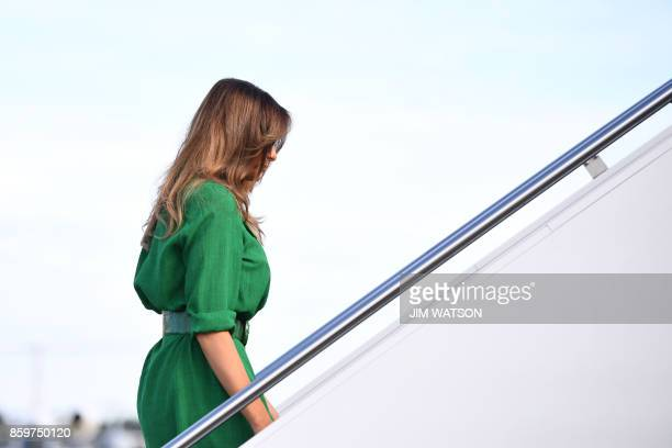 US First Lady Melania Trump prepares to board a plane at Joint Base Andrews near Washington on October 10 2017 Melania Trump will fly to West...