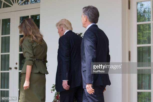 First Lady Melania Trump President Donald Trump and Argentina's President Mauricio Macri head to the Oval Office of the White House in Washington DC...