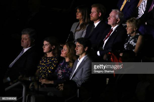 S first lady Melania Trump Prince Harry and Canadian Prime Minister Justin Trudeau watch the opening ceremony of the 2017 Invictus Games at Air...