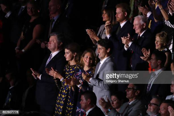 S first lady Melania Trump Prince Harry and Canadian Prime Minister Justin Trudeau clap during the opening ceremony of the 2017 Invictus Games at Air...
