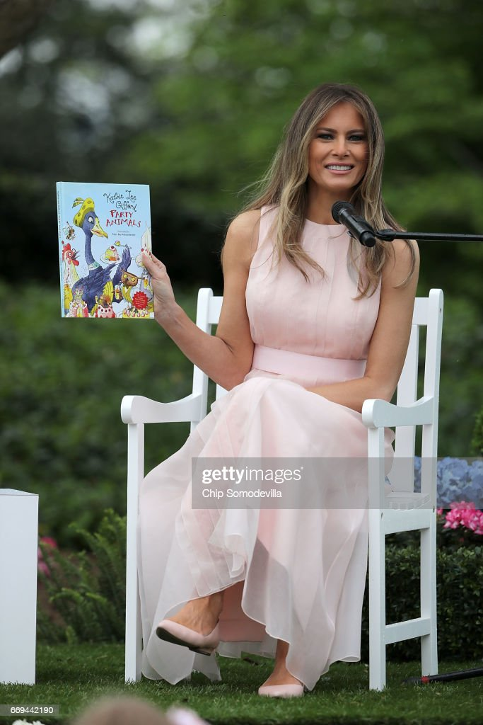 U.S. first lady Melania Trump reads 'Party Animals' by Kathy Lee Gifford during the 139th Easter Egg Roll on the South Lawn of the White House April 17, 2017 in Washington, DC. The White House said 21,000 people are expected to attend the annual tradition of rolling colored eggs down the White House lawn that was started by President Rutherford B. Hayes in 1878.