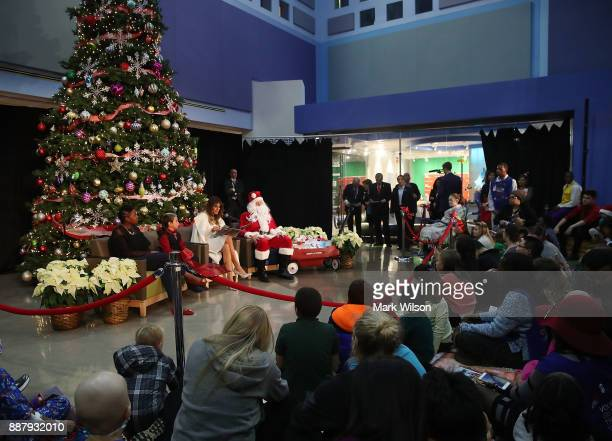 First lady Melania Trump reads the Christmas book The Polar Express at Children's National Medical Center on December 7 2017 in Washington DC First...