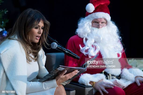 US first lady Melania Trump reads to patients at Children's National Medical Center December 7 2017 in Washington DC / AFP PHOTO / Brendan Smialowski