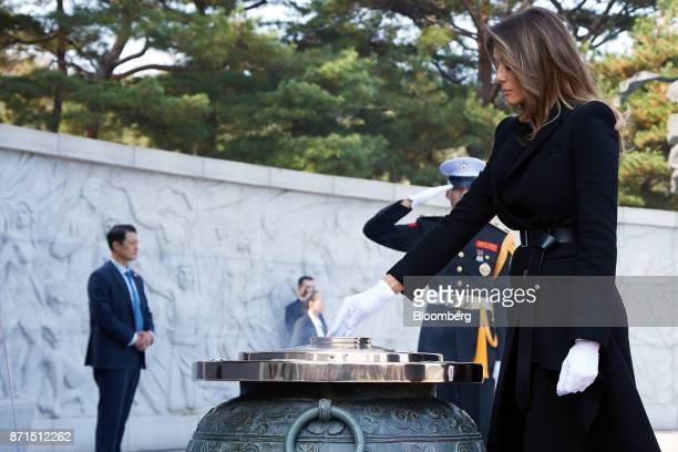 US First Lady Melania Trump releases incense into a large ceremonial urn during a wreathlaying ceremony at the National Cemetery in Seoul South Korea...