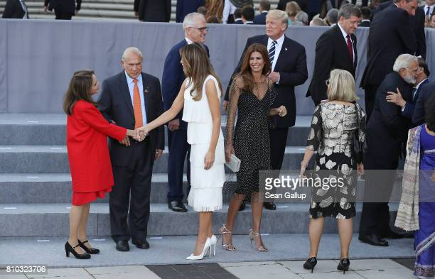 S First Lady Melania Trump shakes hands with a guest as Argentinian First Lady Juliana Awada turns towards them as Australian Prime Minister Malcolm...