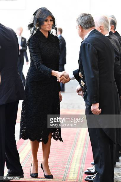 US First Lady Melania Trump shakes hands with officials as she arrives at the Vatican on May 24 2017 US President Donald Trump met Pope Francis at...