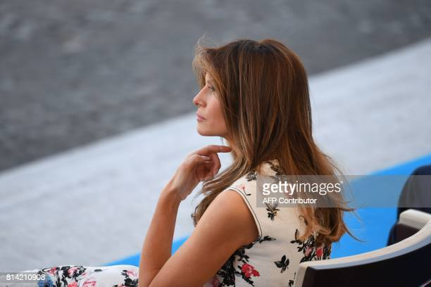 US First Lady Melania Trump sits during the annual Bastille Day military parade on the ChampsElysees avenue in Paris on July 14 2017 / AFP PHOTO /...