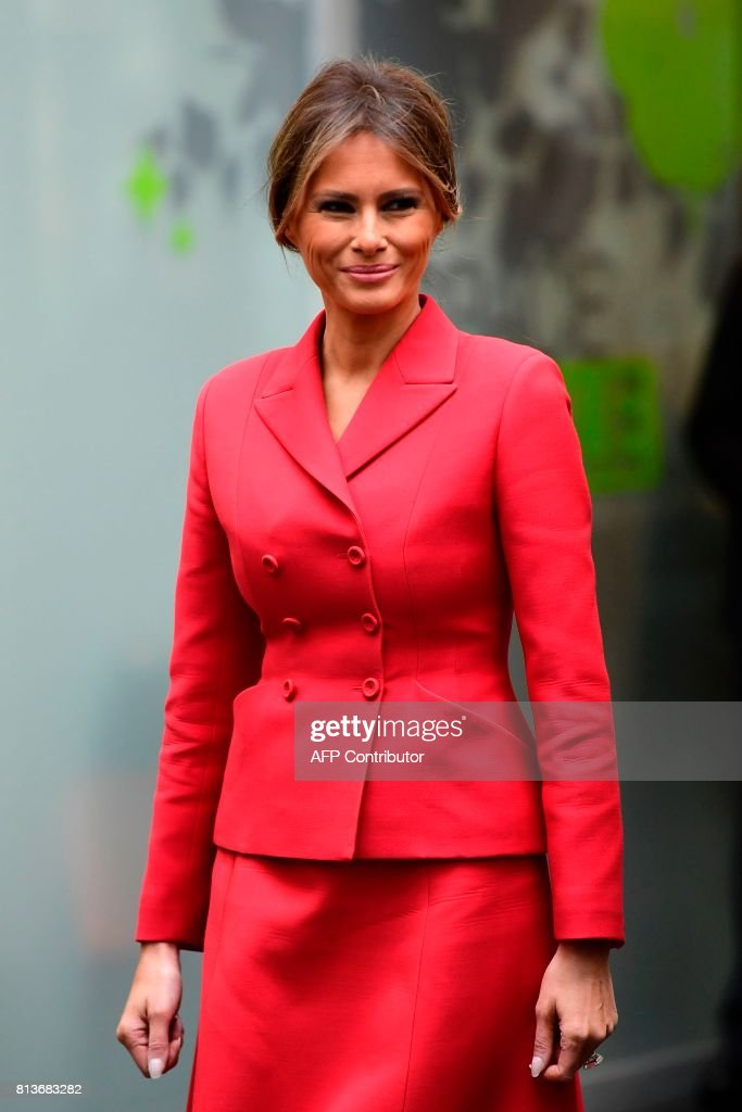 US First Lady Melania Trump smiles during a visit to the Necker Hospital in Paris, on July 13, 2017. US President arrived in Paris for a presidential visit filled with Bastille Day pomp and which the White House hopes will offer respite from rolling scandal backing home. / AFP PHOTO / Martin BUREAU