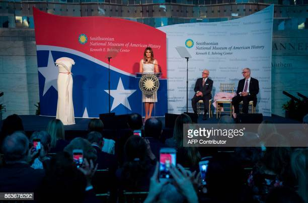 US First Lady Melania Trump speaks alongside the gown she wore to the 2017 inaugural balls as she donates the dress to the Smithsonian's First Ladies...