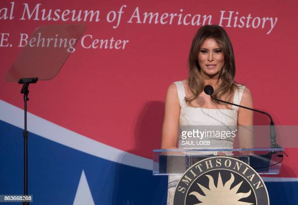 US First Lady Melania Trump speaks as she donates the gown she wore to the 2017 inaugural balls to the Smithsonian's First Ladies Collection at the...