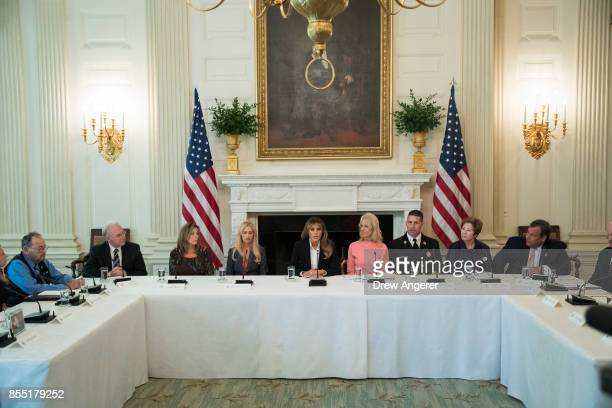 First Lady Melania Trump speaks during a listening session regarding the opioid crisis in the State Dining Room of the White House September 28 2017...