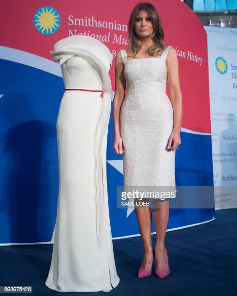 US First Lady Melania Trump stands alongside the gown she wore to the 2017 inaugural balls as she donates the dress to the Smithsonian's First Ladies...