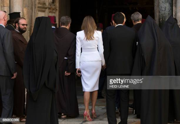 US First Lady Melania Trump stands among religious dignitaries during a visit to the Church of the Holy Sepulchre in the Old City of Jerusalem on May...