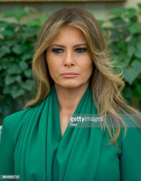 First lady Melania Trump stands as US President Donald Trump meets King Abdullah II of Jordan in the Oval Office of the White House on April 5 2017...
