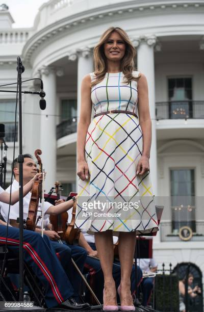 US First Lady Melania Trump stands on stage at the Congressional picnic at the White House in Washington DC on June 22 2017 / AFP PHOTO / NICHOLAS...