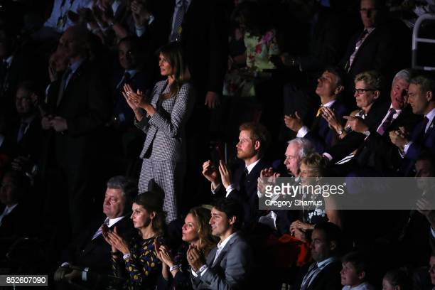 S first lady Melania Trump stands up as Team USA enters the arena during the opening ceremony of the 2017 Invictus Games at Air Canada Centre on...