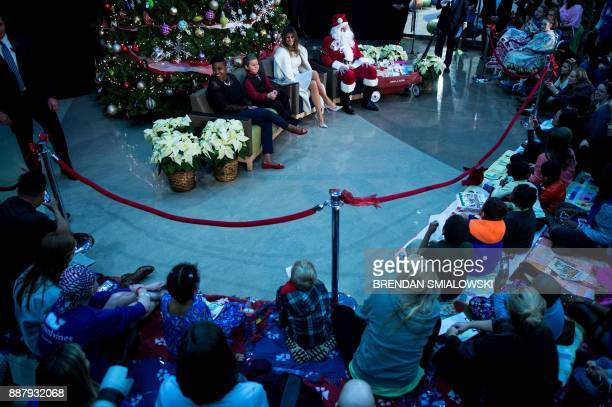 US first lady Melania Trump takes questions from patients before reading to them at Children's National Medical Center December 7 2017 in Washington...
