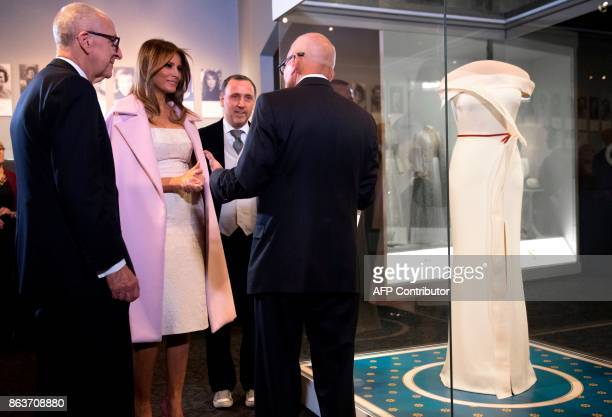 US First Lady Melania Trump talks alongside the gown she wore to the 2017 inaugural balls with the gown's designer Herve Pierre Smithsonian Director...