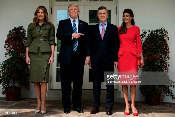 US First Lady Melania Trump US President Donald Trump Argentina's President Mauricio Macri and Argentina's First Lady Juliana Awada pose outside the...
