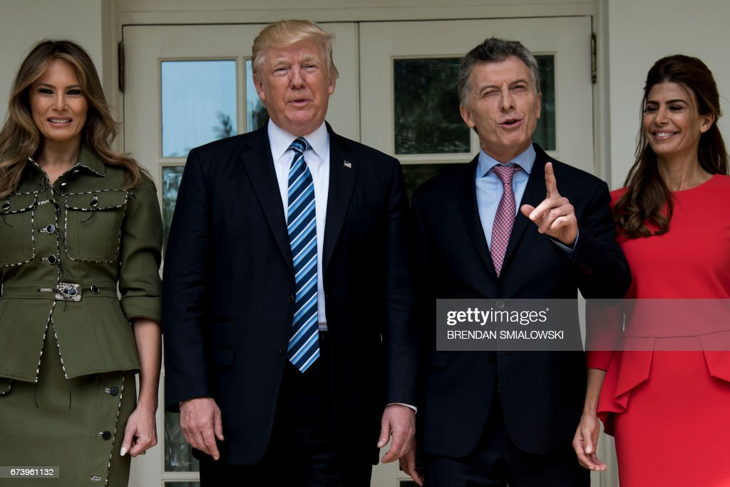 US First Lady Melania Trump, US President Donald Trump, Argentina's President Mauricio Macri, and Argentina's First Lady Juliana Awada pose outside the West Wing of the White House April 27, 2017 in Washington, DC.