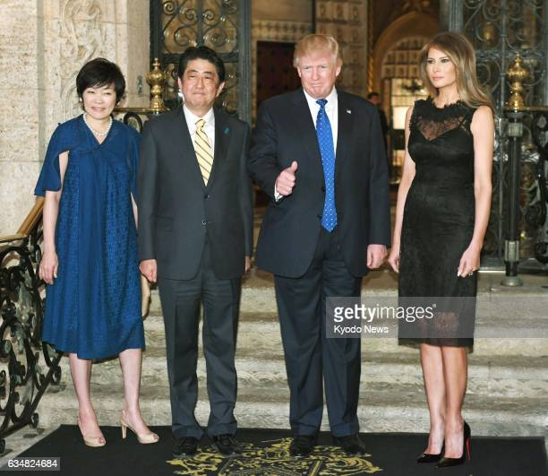 US first lady Melania Trump US President Donald Trump Japanese Prime Minister Shinzo Abe and his wife Akie Abe are ready for a dinner party in Palm...