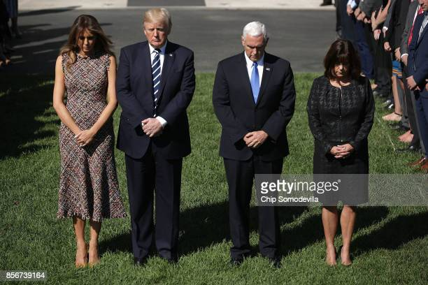 First lady Melania Trump US President Donald Trump Vice President Mike Pence and Karen Pence observe a moment of silence on the South Lawn of the...