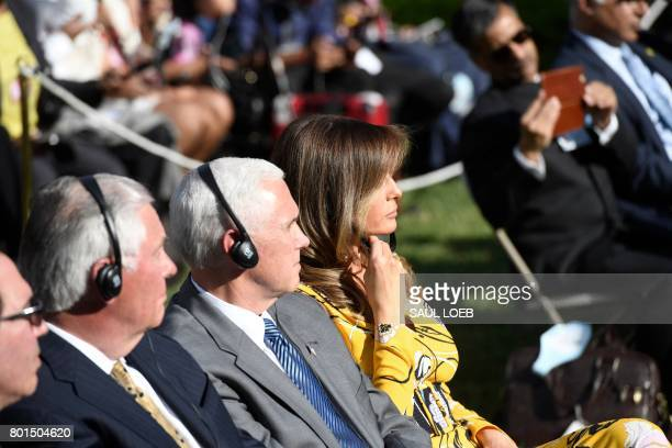 US First Lady Melania Trump US VicePresident Mike Pence and US Secretary of State Rex W Tillerson listen during a press conference to be addressed by...