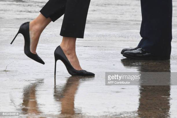 TOPSHOT First Lady Melania Trump walks on high heels to board Air Force One at Andrews Air Force Base Maryland on August 29 2017 en route to Texas to...