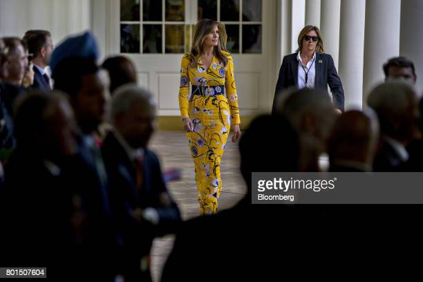 US First Lady Melania Trump walks through the Colonnade of the White House before a joint statement with US President Donald Trump and Indian Prime...