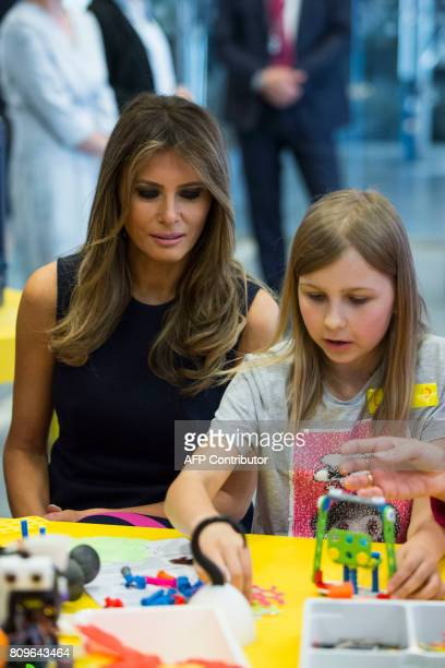 First Lady Melania Trump watches children playing as she visits the Copernicus Science Center with the Polish President's wife in Warsaw on July 6...