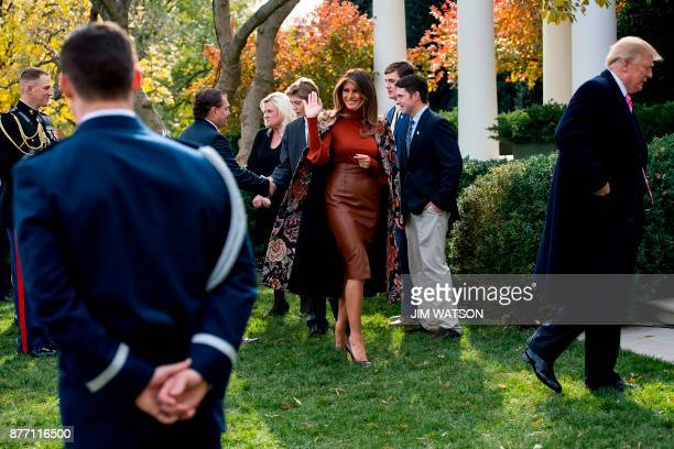 First Lady Melania Trump waves after US President Donald Trump pardoned the Thanksgiving turkey Drumstick in the Rose Garden of the White House in...