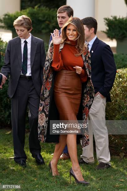 S first lady Melania Trump waves goodbye as she and her son Barron Trump leave following the pardoning ceremony of the National Thanksgiving Turkey...