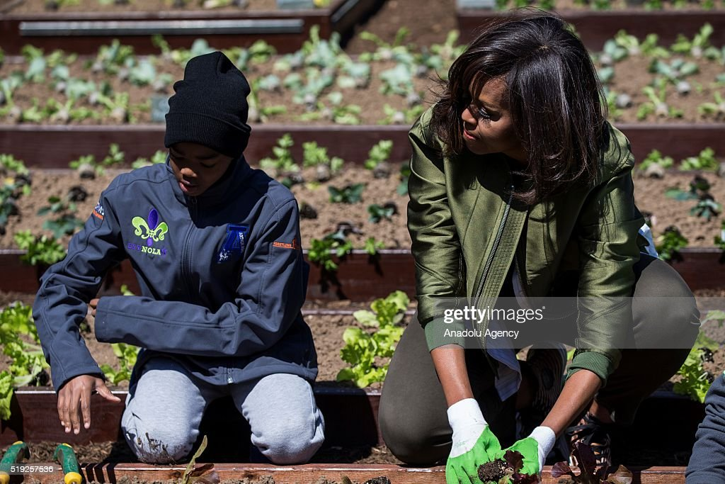 First Lady Michele Obama plants lettuce with Malik Robins in the 2016 White House Kitchen Garden in Washington USA on April 5 2016