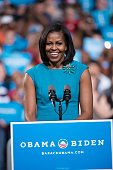 First Lady Michele Obama speaks to supporters of her husband President Barack Obama at a campaign rally at the Value City Arena on the campus of Ohio...