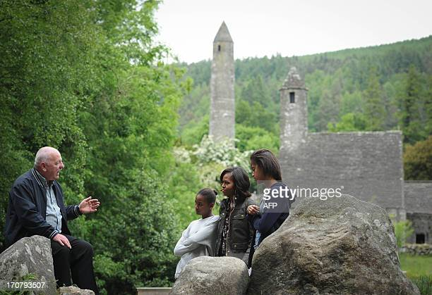 US First Lady Michelle Obama accompanied by her two daughters Sasha and Malia visits Glendalough with tour guide George McClafferty in the Wicklow...