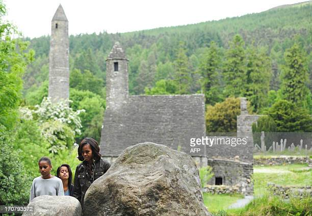 US First Lady Michelle Obama accompanied by her two daughters Sasha and Malia visit Glendalough in the Wicklow Mountains National Park in Ireland on...