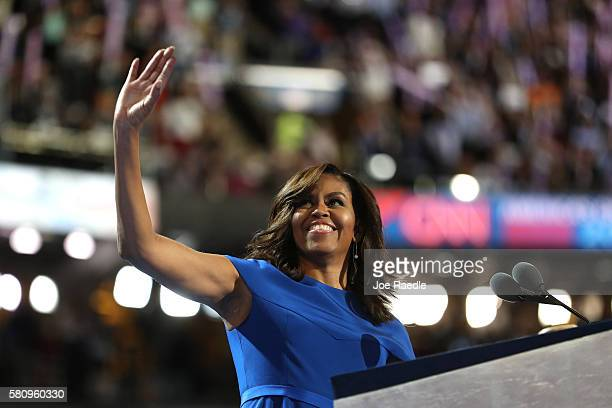 First lady Michelle Obama acknowledges the crowd before delivering remarks on the first day of the Democratic National Convention at the Wells Fargo...