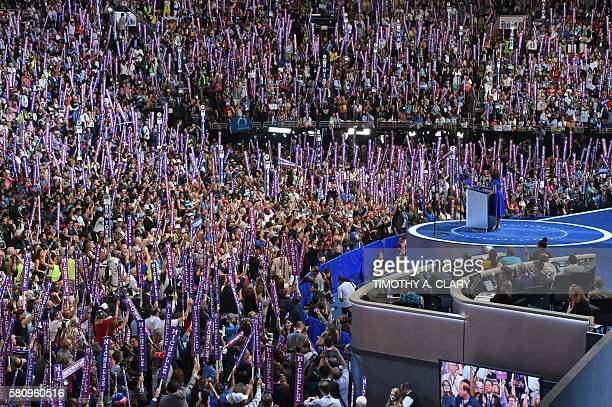 US First Lady Michelle Obama addresses delegates on Day 1 of the Democratic National Convention at the Wells Fargo Center in Philadelphia...