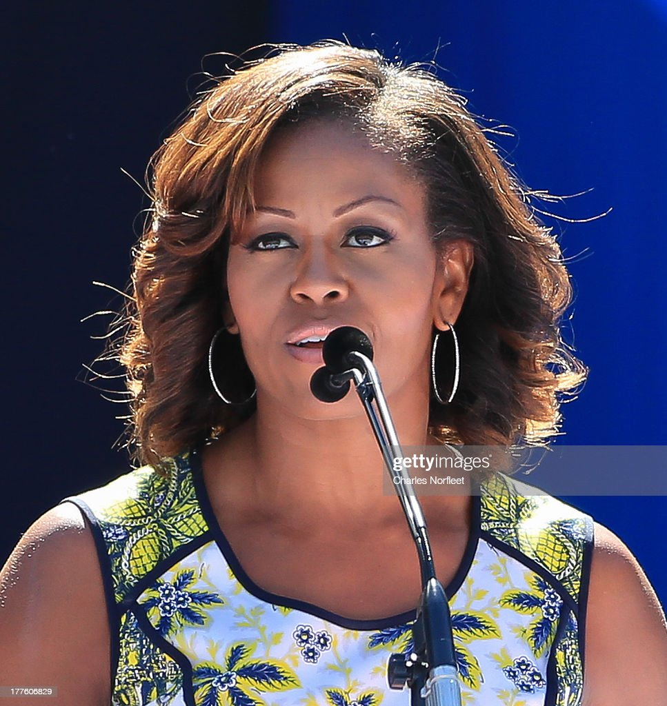 First Lady <a gi-track='captionPersonalityLinkClicked' href=/galleries/search?phrase=Michelle+Obama&family=editorial&specificpeople=2528864 ng-click='$event.stopPropagation()'>Michelle Obama</a> addresses the crowd during the 2013 Arthur Ashe Kids Day at USTA Billie Jean King National Tennis Center on August 24, 2013 in the Queens borough of New York City.