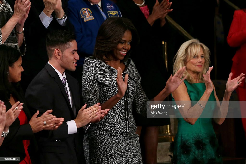 First lady <a gi-track='captionPersonalityLinkClicked' href=/galleries/search?phrase=Michelle+Obama&family=editorial&specificpeople=2528864 ng-click='$event.stopPropagation()'>Michelle Obama</a> (C), alongside Dr. <a gi-track='captionPersonalityLinkClicked' href=/galleries/search?phrase=Jill+Biden&family=editorial&specificpeople=997040 ng-click='$event.stopPropagation()'>Jill Biden</a> (R), waves after arriving before the start of U.S. President Barack Obama's State of the Union speech January 20, 2015 in Washington, DC. Obama was expected to lay out a broad agenda to including attempts to address income inequality and making it easier for Americans to afford college education and child care.