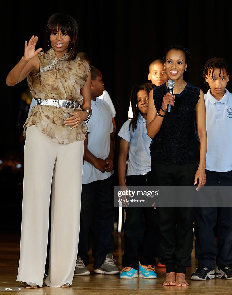 U.S. first lady <a gi-track='captionPersonalityLinkClicked' href=/galleries/search?phrase=Michelle+Obama&family=editorial&specificpeople=2528864 ng-click='$event.stopPropagation()'>Michelle Obama</a> and actress <a gi-track='captionPersonalityLinkClicked' href=/galleries/search?phrase=Kerry+Washington&family=editorial&specificpeople=201534 ng-click='$event.stopPropagation()'>Kerry Washington</a> speak to students during an event while visiting the Savoy School May 24, 2013 in Washington, DC. The Savoy School, once one of the lowest performing schools in the District of Columbia, has shown significant signs of improvement since being designated as one of eight schools selected last year for the Turnaround Arts Initiative by the President's Committee on the Arts and the Humanities.