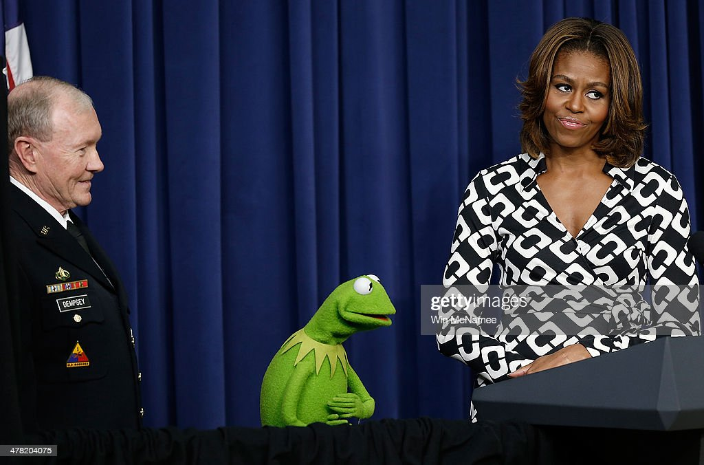 U.S. first lady <a gi-track='captionPersonalityLinkClicked' href=/galleries/search?phrase=Michelle+Obama&family=editorial&specificpeople=2528864 ng-click='$event.stopPropagation()'>Michelle Obama</a> (R) and Chairman of the Joint Chiefs of Staff Gen. <a gi-track='captionPersonalityLinkClicked' href=/galleries/search?phrase=Martin+Dempsey&family=editorial&specificpeople=2116621 ng-click='$event.stopPropagation()'>Martin Dempsey</a> (L) welcome Kermit the Frog during a screening of Disney's 'Muppets Most Wanted' at the Eisenhower Executive Office Building March 12, 2014 in Washington, DC. The movie's preview was for an audience of military children and families as part of the Joining Forces Initiative.