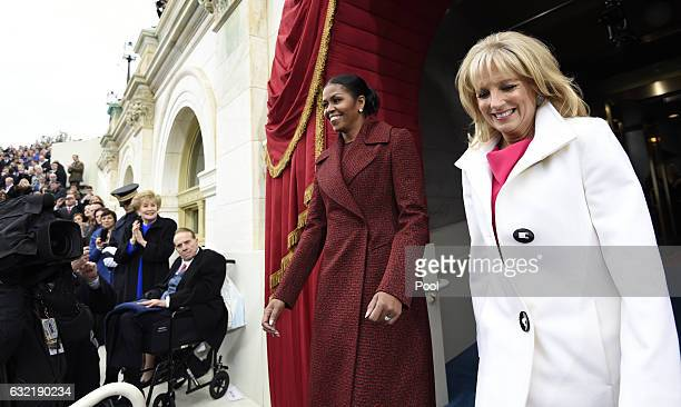 First Lady Michelle Obama and Dr Jill Biden arrive for the Presidential Inauguration of Donald Trump at the US Capitol on January 20 2017 in...