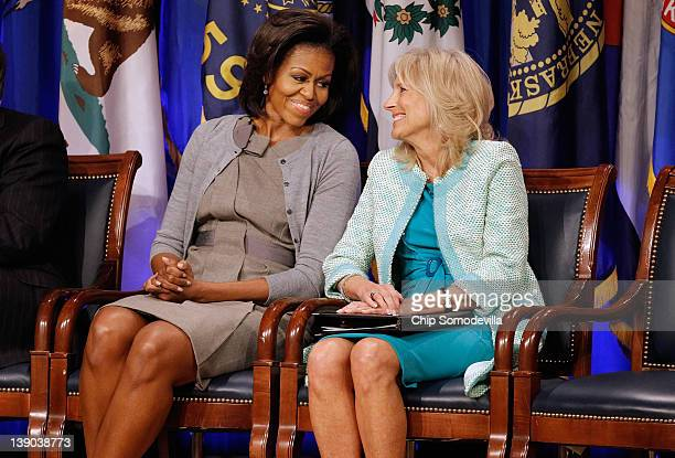S first lady Michelle Obama and Dr Jill Biden attend an event to announce a new report regarding military spouse employment at the Pentagon February...