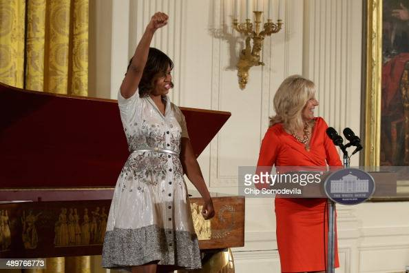 First lady Michelle Obama and Dr Jill Biden host the annual Mother's Day tea to honor military mothers at the White House May 12 2014 in Washington...