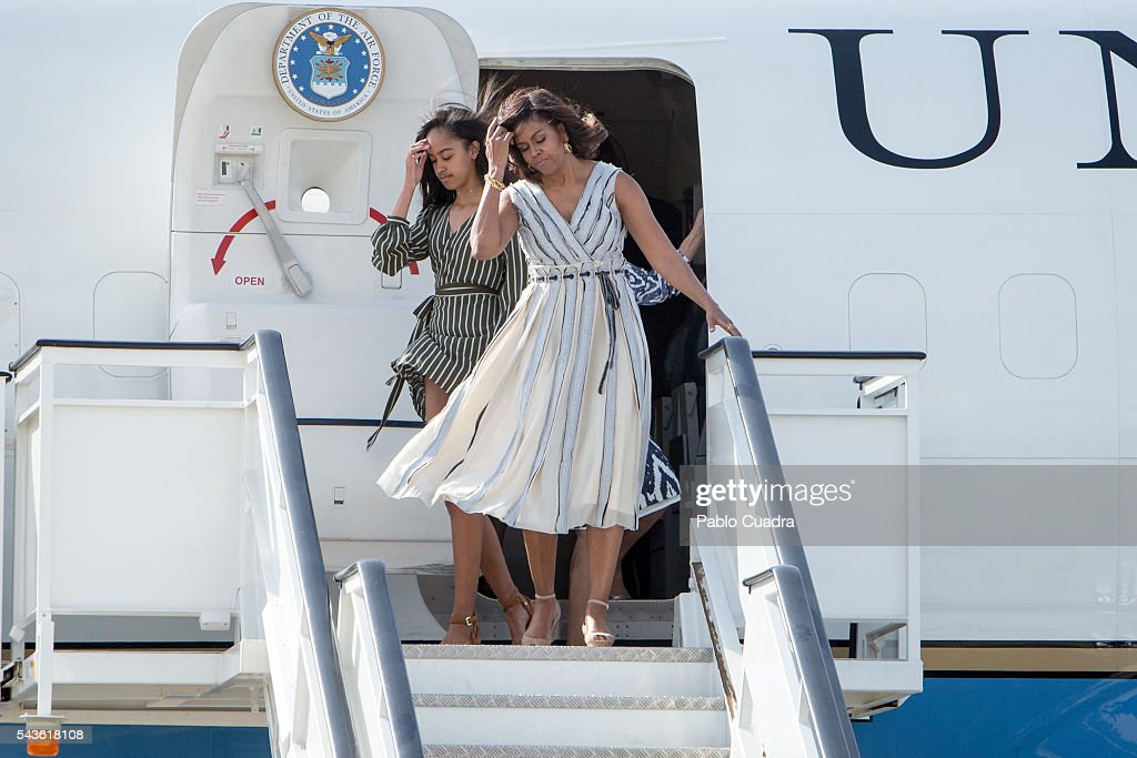US First Lady <a gi-track='captionPersonalityLinkClicked' href=/galleries/search?phrase=Michelle+Obama&family=editorial&specificpeople=2528864 ng-click='$event.stopPropagation()'>Michelle Obama</a> and her daughter <a gi-track='captionPersonalityLinkClicked' href=/galleries/search?phrase=Malia+Obama&family=editorial&specificpeople=2631620 ng-click='$event.stopPropagation()'>Malia Obama</a> arrive at Torrejon Air Force Base on June 29, 2016 in Madrid. The First Lady will deliver a speech on Let Girls Learn to girls and young women, sharing the stories of girls she has met in her prior travels and highlighting new commitments to support Let Girls Learn. Mrs. Obama will encourage the audience to value their own educational opportunities, continue to strive for progress for girls and young women in their country, and take action to help the more than 62 million girls around the world who are out of school, 2016 in Madrid, Spain.