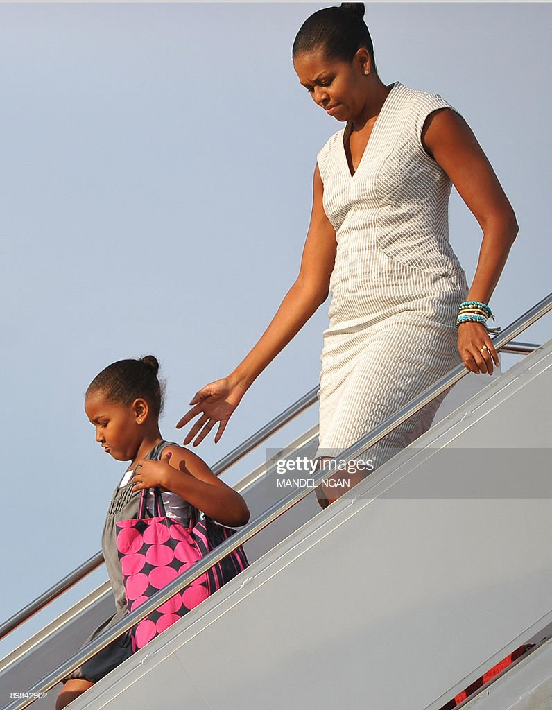 US First Lady <a gi-track='captionPersonalityLinkClicked' href=/galleries/search?phrase=Michelle+Obama&family=editorial&specificpeople=2528864 ng-click='$event.stopPropagation()'>Michelle Obama</a> and her daughter Sasha step off Air Force One with upon arrival at Andrews Air Force Base in Maryland. US President Barack Obama and his family returned to Washington after a weekend visit to Montana, Wyoming, Colorado and Arizona. AFP PHOTO/Mandel NGAN